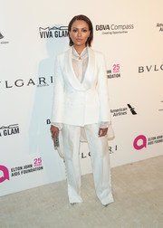 Kat Graham went the masculine-chic route in a white Ermanno Scervino tuxedo at the Elton John AIDS Foundation Oscar-viewing party.