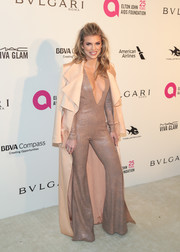 AnnaLynne McCord was a '70s babe in a rose-gold jumpsuit with a flared hem and a plunging neckline at the Elton John AIDS Foundation Oscar-viewing party.