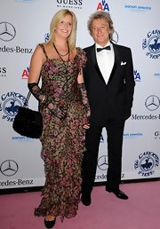 Penny Lancaster carried an elegant tote to the Carousel of Hope anniversary party.
