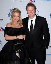 Kathy Hilton finished off her ultra-feminine ensemble with a black satin evening purse.
