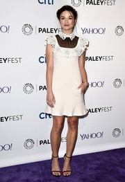 Crystal Reed oozed ultra-girly charm during PaleyFest in a Valentino LWD with a wavy hem, a laser-cut collar and yoke, and a contrasting sheer black neckline.
