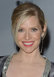 With her bangs swept to the side and the rest of her hair in an updo, Emily Procter looked downright gorgeous.