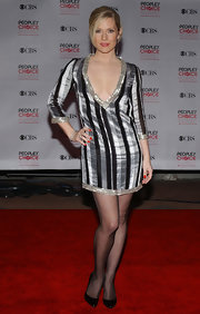 Emily Procter was a knockout in a shimmery black and silver dress with a provocative deep-V neckline.