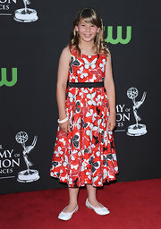 Bindi charmed on the red carpet in a conservative butterfly-print dress.