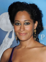 Tracee Ellis Ross wore a pair of gold dangle earrings to the NAACP Image Awards.