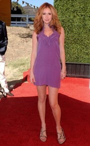 Ashley Jones showed plenty of leg in a lingerie-inspired purple mini dress during the Veuve Clicquot Polo Classic.