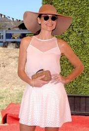 Minnie Driver looked very summery in a sheer-panel pink top and a flared mini skirt during the Veuve Clicquot Polo Classic.
