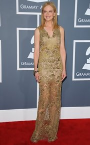 Nicole Kidman showed off her statuesque figure in this gold beaded column dress on the Grammy red carpet.