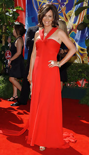 Jane Kaczmarek wore a flowy halter dress in an eye-catching red hue to the Emmy Awards.
