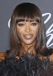 Naomi switched up her long locks for a slighted curled out bob with blunt-cut bangs.