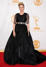 Vera made a statement in a belted, black gown with a full-bodied skirt and sheer sleeves.