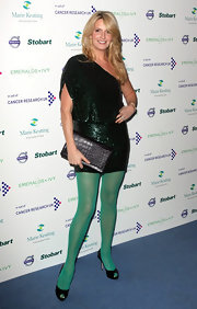 Penny Lancaster arrived at the Emeralds & Ivy Ball in her suede peep-toe pumps.