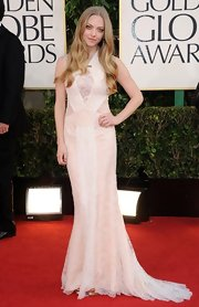 Amanda was another star to don an ethereal white number to the Golden Globes. Hers was an intricate lace design with a delicate train.