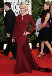 Naomi vamped it up on the red carpet in this deep burgundy gown with a delicate keyhole and dramatic long train.