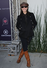 Gina Gershon completed her ensemble with a pair of camel-colored knee-high boots.