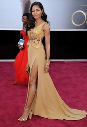 Naomie Harris was gold from head to toe at the 2013 Oscars with these gold strappy heels.