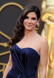 Sandra Bullock's curly side sweep and strapless gown at the Oscars were a truly swoon-worthy pairing.