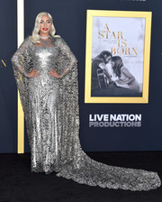 Lady Gaga went full-on glam in a caped silver lace gown by Givenchy Couture at the premiere of 'A Star is Born.'