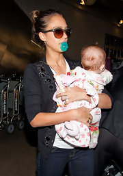 Which is more adorable? Jessica Alba's olive cateyes or her baby's aqua pacifier?