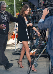 Alessandra Ambrosio teetered on black and gold ankle-strap heels by Giuseppe Zanotti as she headed to 'Extra.'