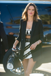 Alessandra Ambrosio headed to 'Extra' carrying a stylish black-and-white leather tote.