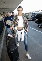 Alessandra Ambrosio arrived on a flight at LAX looking tough in a camo-print jacket.