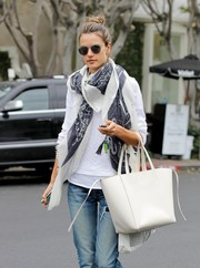 Alessandra Ambrosio accessorized a simple white top with a patterned scarf for a day out in LA.