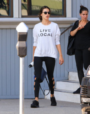 Alessandra Ambrosio kept it comfy in a white Sundry 'Live Local' sweatshirt and black cutout leggings while out in LA.