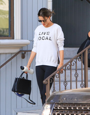 Alessandra Ambrosio headed out in LA carrying a simple yet stylish black leather tote by Fendi.