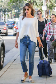 Alessandra Ambrosio was casual yet stylish in a white boatneck sweater and blue jeans while out and about.