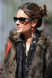 Alessandra Ambrosio showed off a cool pair of sunglasses that she rocked with a twisted high bun.