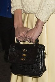Alexa Chung opted for a brown leather tote bag for her carry-all while out in Soho's red light district in London.