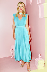 Nicky Hilton looked effortlessly chic in a sky-blue Alice + Olive midi dress, featuring a V-neckline, choker detail, and a pleated skirt, during the brand's presentation.