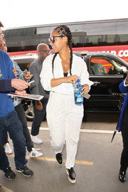 Alicia Keys took a flight out of LAX wearing a casual white jumpsuit.