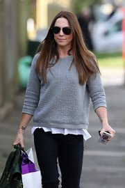 Mel C topped off her casual look with a pair of dark aviators while out on a stroll in London.
