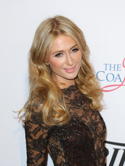 Paris Hilton topped off her look with long, center-parted curls when she attended the Power Up Gala.
