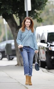 Alyson Hannigan chose a flowing print blouse for her daytime look while out grabbing coffee.