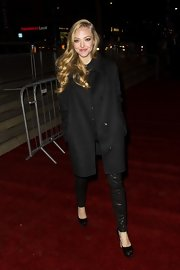 Amanda matched her shiny leather pants with a classic wool coat for the 'Les Mis' after-party.