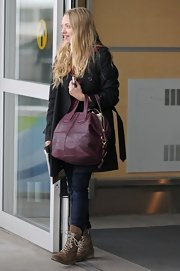 Amanda Seyfried showed off a cool pair of lace up tan boots while hitting LAX airport.