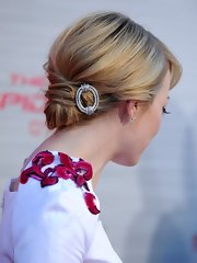 Emma Stone tied her hair in a low knot with a statement hairpin for the 'Amazing Spider-Man' premiere.