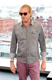 Rhys went for a casual, relaxed look with a washed-out gray denim button-down.