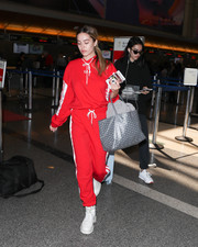 Delilah Hamlin matched her top with a pair of red I.am.gia sweatpants.