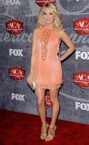 Carrie loves bedazzling beaded designs like this tangerine cocktail dress she wore to the ACAs.