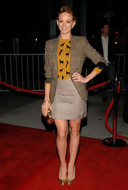 Jayma Mays accessorized her red carpet look with metallic gold stilettos.