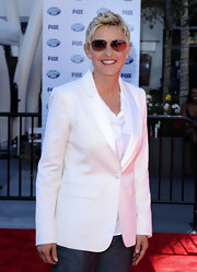 Ellen walked the red carpet in a sleek white blazer.