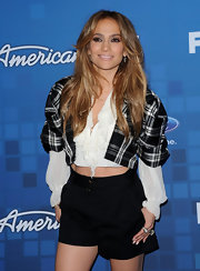 Jennifer dons black high-waisted shorts with her cropped blouse at the American Idol finalist party.