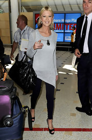 Tara Reid pulled her together with a stylish black patent travel bag.