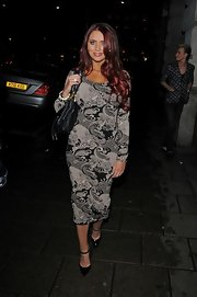 Amy Childs showed off her curves with this gray paisley print dress while out in London.