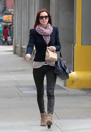Eva Amurri hit the city streets in charcoal skinny jeans and a pair of on-trend ankle boots.