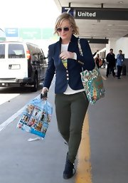 Amy Poehler chose this navy blazer to pair over her graphic tee for a more dressed up travel look.